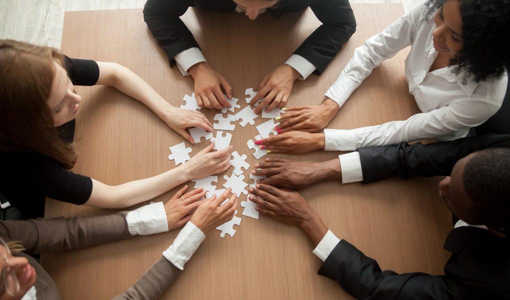 bigstock Diverse Team People Assembling 240398266